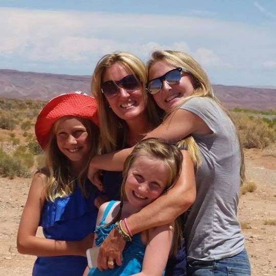 tryna fitzpatrick with three daughters near the Grand Canyon