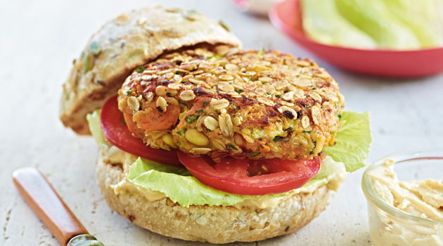 eggplant sweet potato burgers on bun with tomato and lettuce, healthy